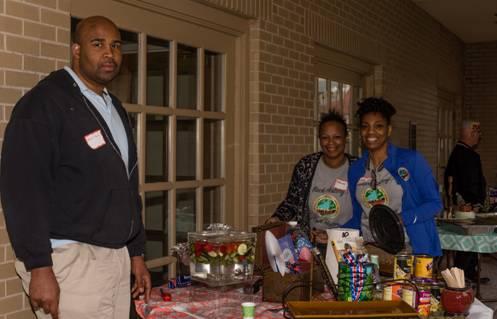 AT&T Community Network volunteers displaying American soul food